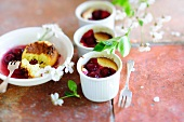 Cherry soufflés in ramekins and in a dessert bowl with stewed cherries