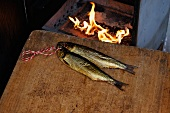 Smoked fish in front of the fire