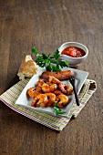 Smoked prawns with sausage and tomato sauce