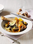 Pot-roasted chicken with oranges, vegetables and olives