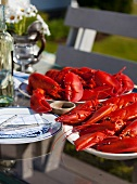 Platters of Fresh Cooked Lobsters on an Outdoor Table