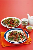 Beef with bamboo shoots, peppers and pak choi on a bed of rice (Canton, China)