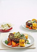 Rump steak with chilli butter on barbecued vegetables