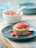 Rhubarb ice cream in a biscuit base on a bed of strawberry and rhubarb compote