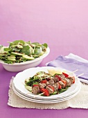 Lamb kebabs with lentil and spinach salad