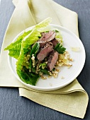 Barley salad with lamb and grapes