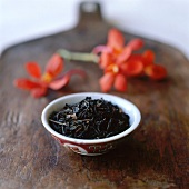 Black Tea Leaves in Chinese Bowl