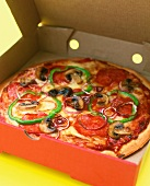 An All Dressed Pizza in a Pizza Box