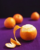 A clementine, partially peeled