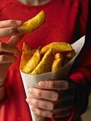 Potato Wedge Chips in Ladies' Hands