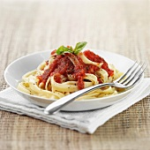 Bowl of tagliatelle pasta with sauce