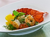 Lobster and prawns in champagne sauce with sprouts, herbs and deep-fried basil leaves