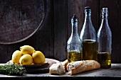 Lemon herbs and baguette with olive oil bottles