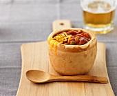 Chilli con carne in an edible bread bowl