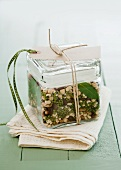 Tarragon bean soup mix in a glass storage container