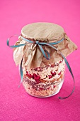 Muesli mix with dried raspberries in a jar