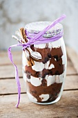 A jar containing dry ingredients for making hot chocolate with marshmallows