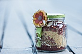 Mix for making an orzo and bean dish, in a jar as a gift: red beans, lentils, white beans, orzo, peppers