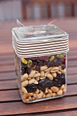 Assorted nuts and raisins layered in a jar as a gift