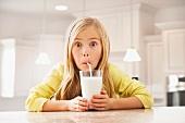 Blonde girl (6-7) drinking milk