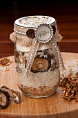 Ingredients for mushroom risotto in a screw-top jar as a gift