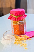 Dried pasta and red lentils in a storage jar as a gift