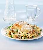 Chicken breast with a creamy sauce and pasta