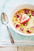 Fruit Gratin with a Fresh Strawberry Garnish and Powdered Sugar
