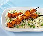 Chicken skewers on a bed of rice