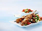 Turkey souvlaki on a bed of Greek salad