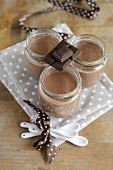 Mousse au chocolat in three screw-top jars