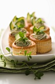 Vol-au-vents filled with courgette and herb paste