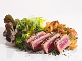 Seared tuna with fried potatoes and salad
