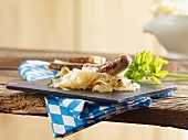 Grilled bratwurst sausages with sauerkraut