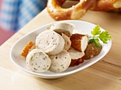 Pretzel and white sausage salad with sweet mustard