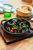 Grilled mussels in a cast iron pan