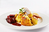Kaiserschmarren with stewed plums (shredded sugared pancake, Austria)