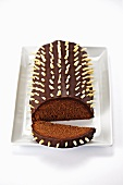 Rehrücken (cake designed to look like a saddle of venison) with chocolate icing and sliced almonds