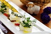 Soft cheese with herbs and olive oil