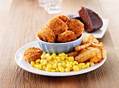 Chicken nuggets with chips and sweetcorn