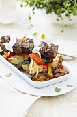 A lamb kebab with roasted vegetables