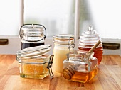 Assorted types of honey in glass containers