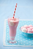 Strawberry milkshake with marshmallows in a glass