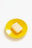 Tofu on a yellow plate