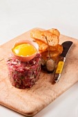Steak tartare with raw egg yolk and crostini