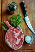 Ribeye steak with salt and fresh herbs