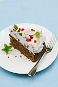 A slice of redcurrant cake with meringue topping and mint