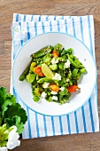 Bean salad with broad beans, peas, carrots, feta and limes