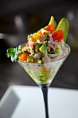 Ceviche with avocado in a stemmed glass