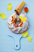 Babka (Easter cake, Poland) with icing sugar and crystallised orange peel